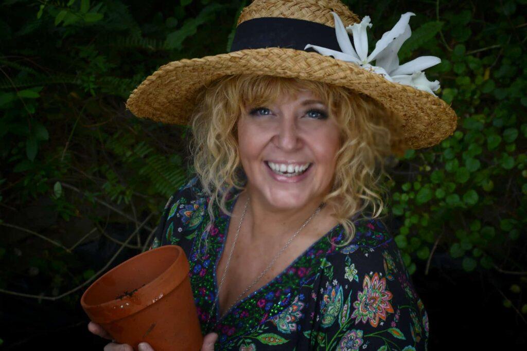 Cheralyn holds a garden pot