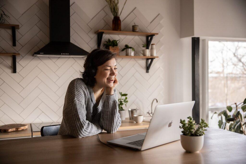 Smiling lady watching her laptop screen